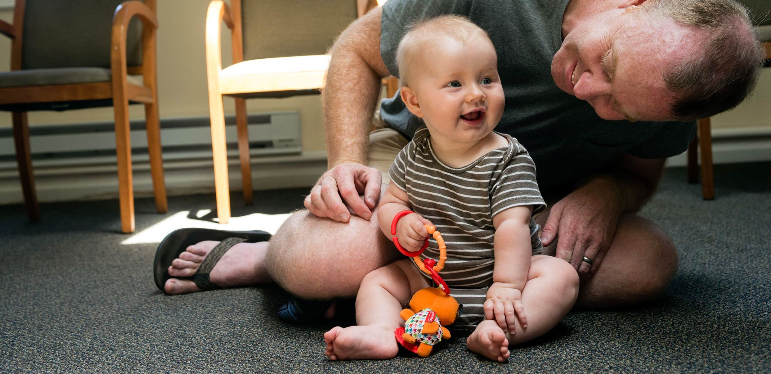 Father plays with baby at a parent support group meeting at Cooley Dickinson Hospital, 30 Locust Street, Northampton, MA 01060.