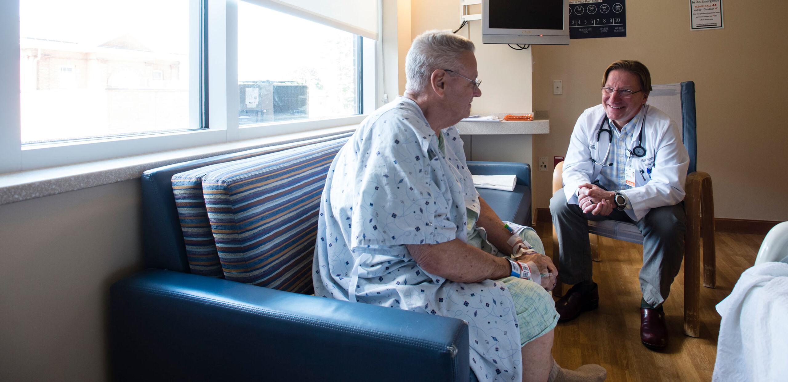 Hospitalist Mark Novotny, MD, talks with patient at Cooley Dickinson Hospital, Northampton, MA 01060