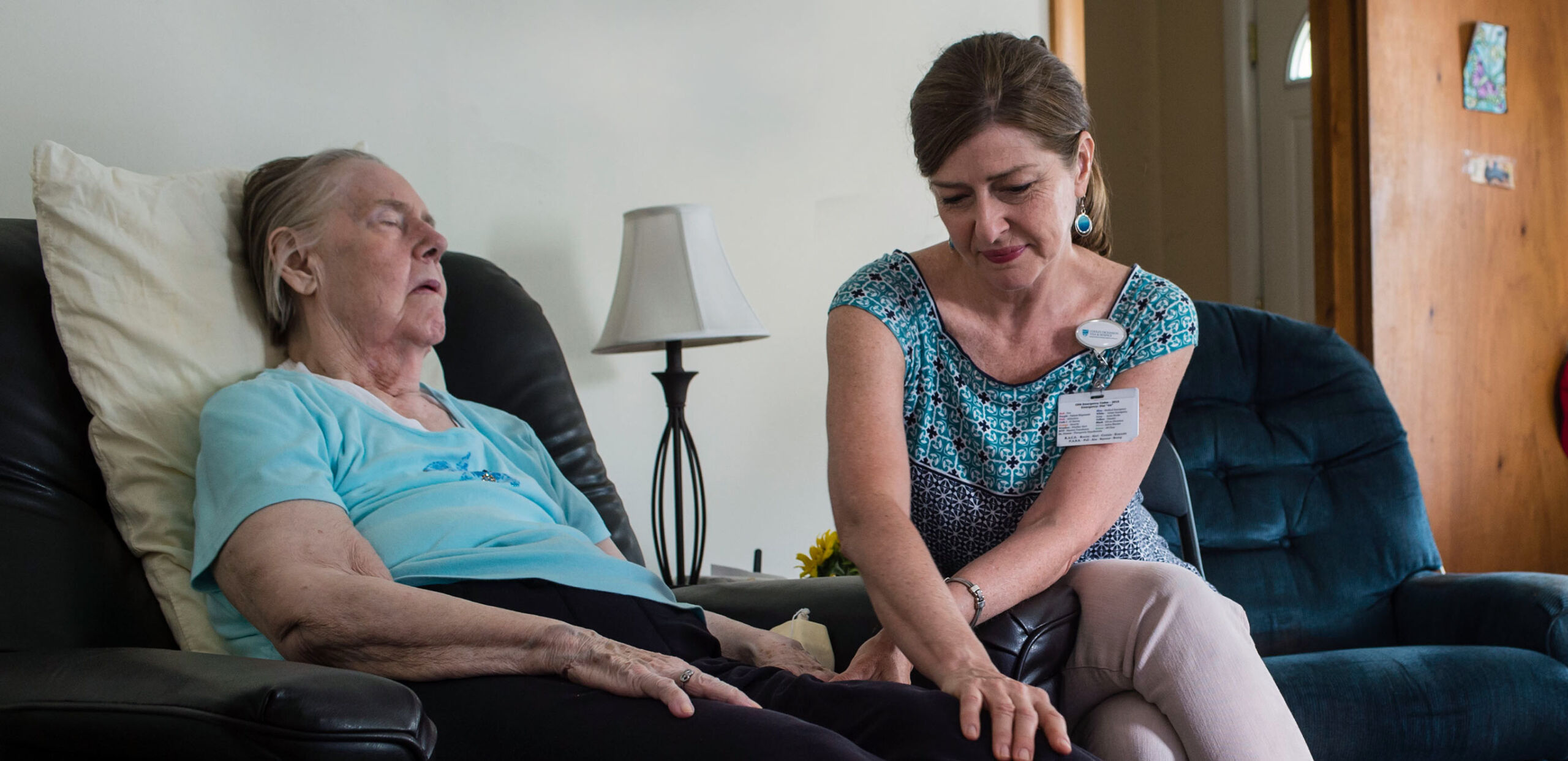 Visiting nurse comforts elderly client in her home, Cooley Dickinson Medical Group Visiting Nurses & Hospice, Northampton, MA 01060.