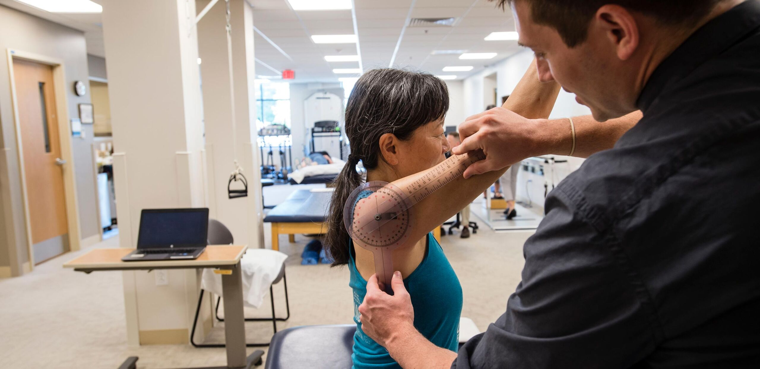 Physical therapist evaluates a female patient's range of arm motion at Cooley Dickinson Medical Group Rehabilitation Services, Northampton, MA 01060.