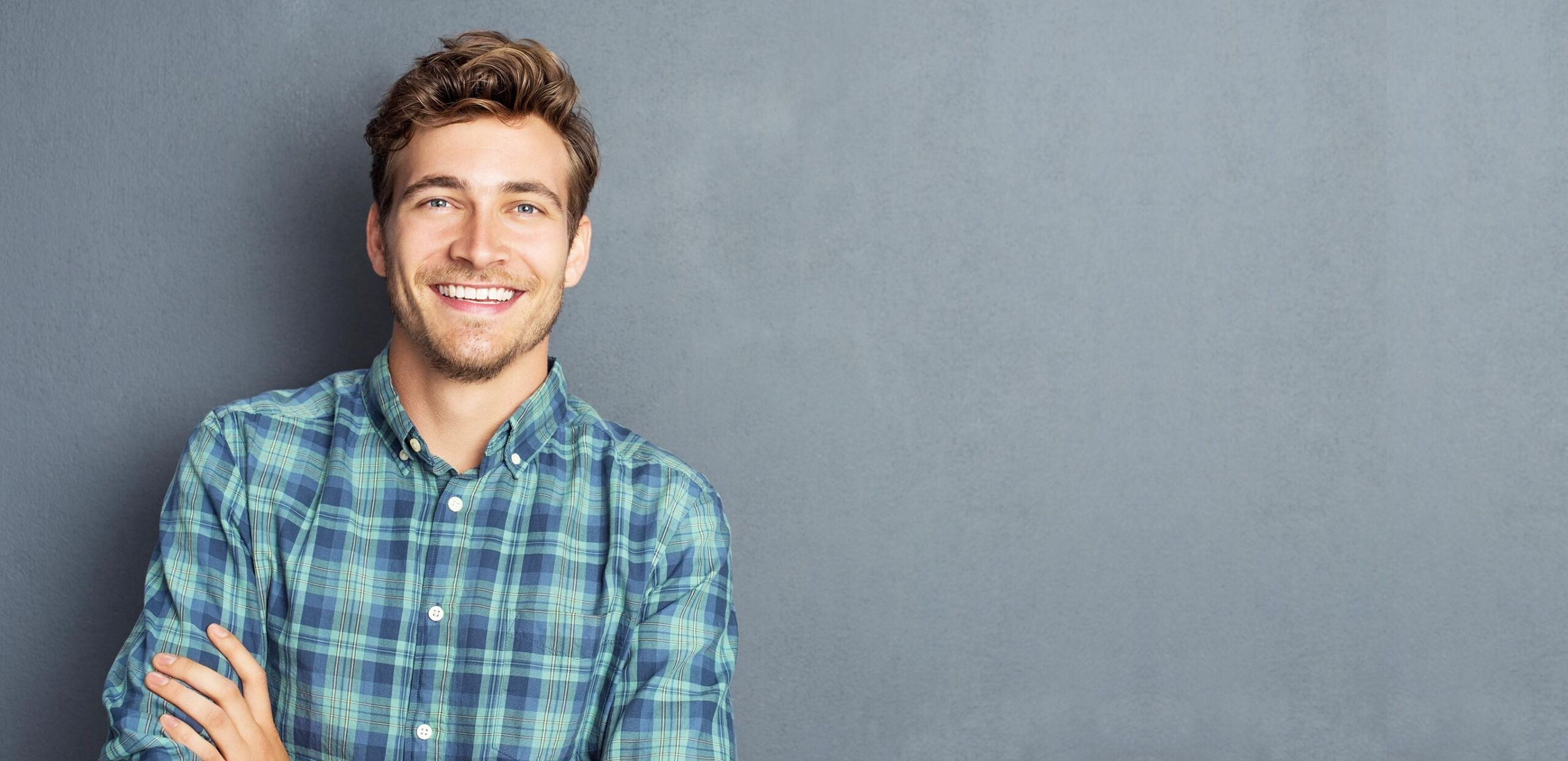 Smiling young man, Cooley Dickinson Medical Group Plastic Surgery, Florence, MA 01062.