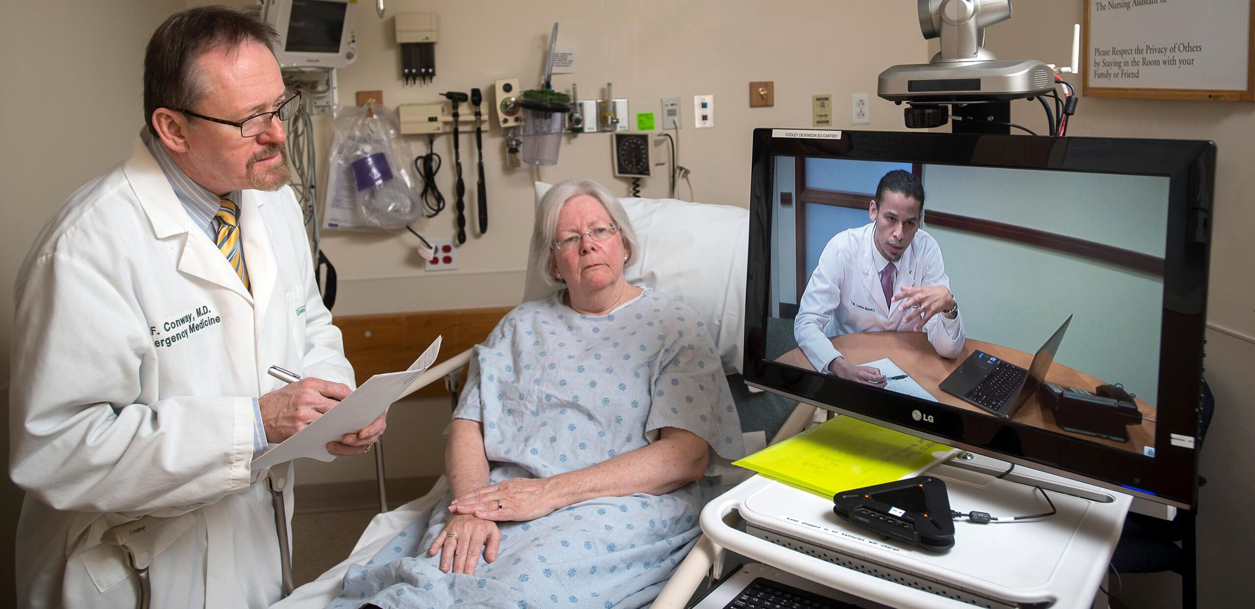 R. F. Conway, MD, and patient use Telehealth system to confer with MGH specialist.