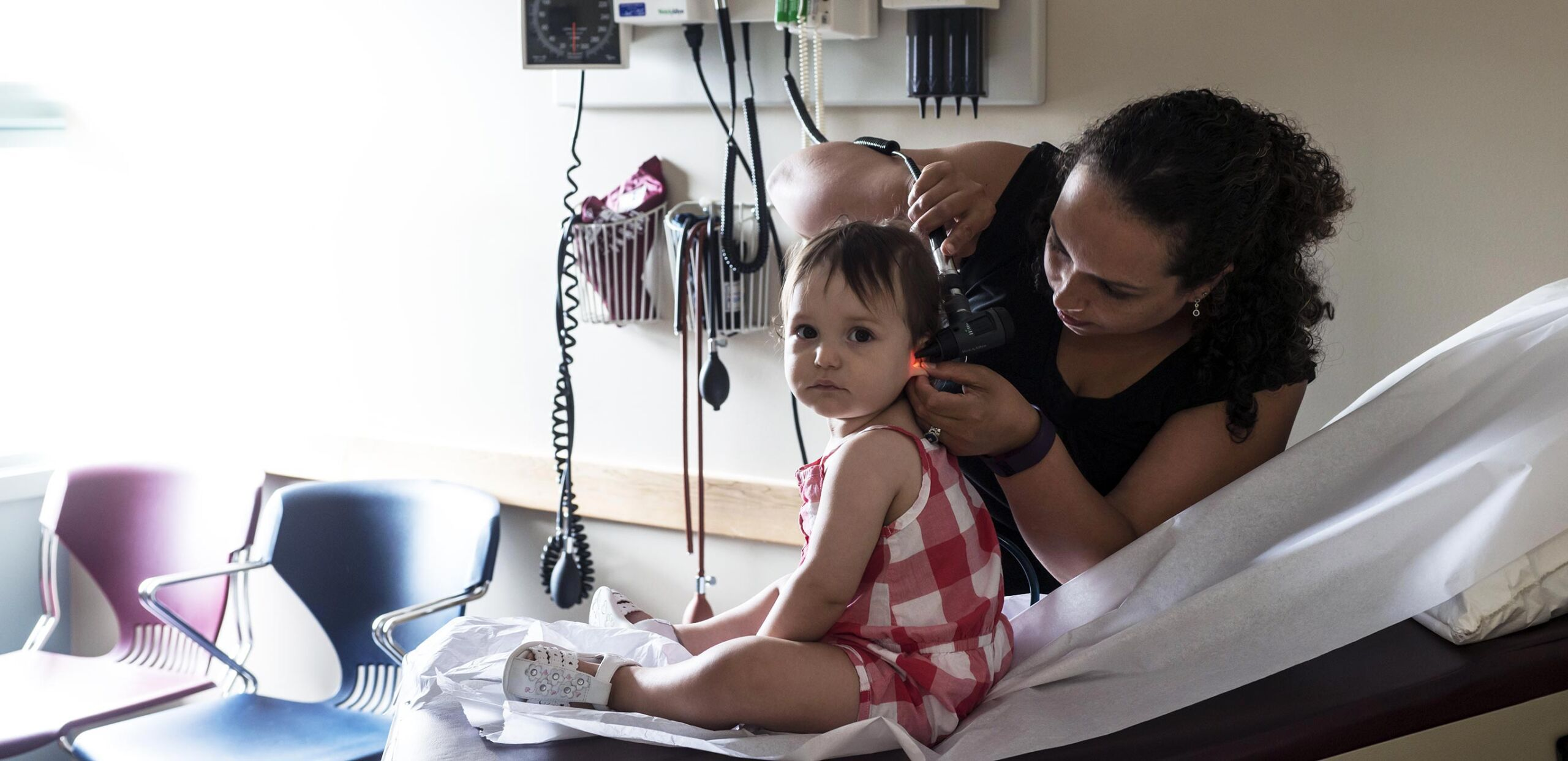 Dr. Yarima Santiago examines a young patient at Cooley Dickinson Medical Group Amherst Medical Associates, Amherst, MA 01002.