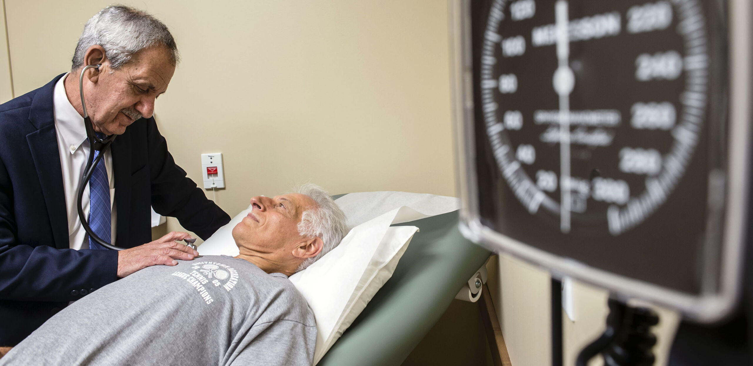 Cardiologist Mark Porway, MD, examines a patient, Hampshire Cardiovascular Associates, Northampton, MA 01060
