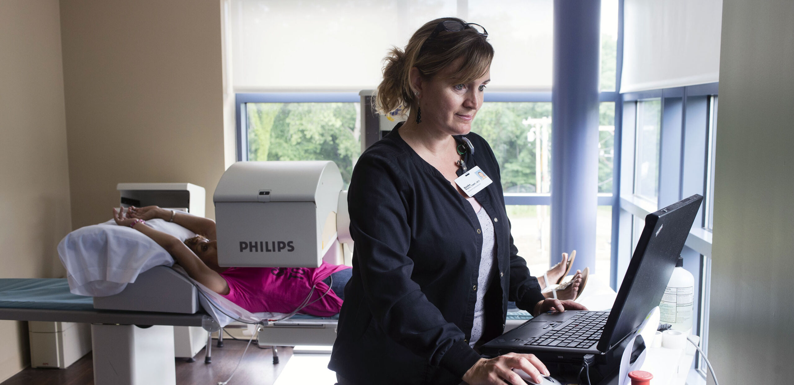 Nuclear Medicine Technologist Brooke Moore monitors a patient during a procedure at Hampshire Cardiovascular Associates, Northampton, MA 01060.