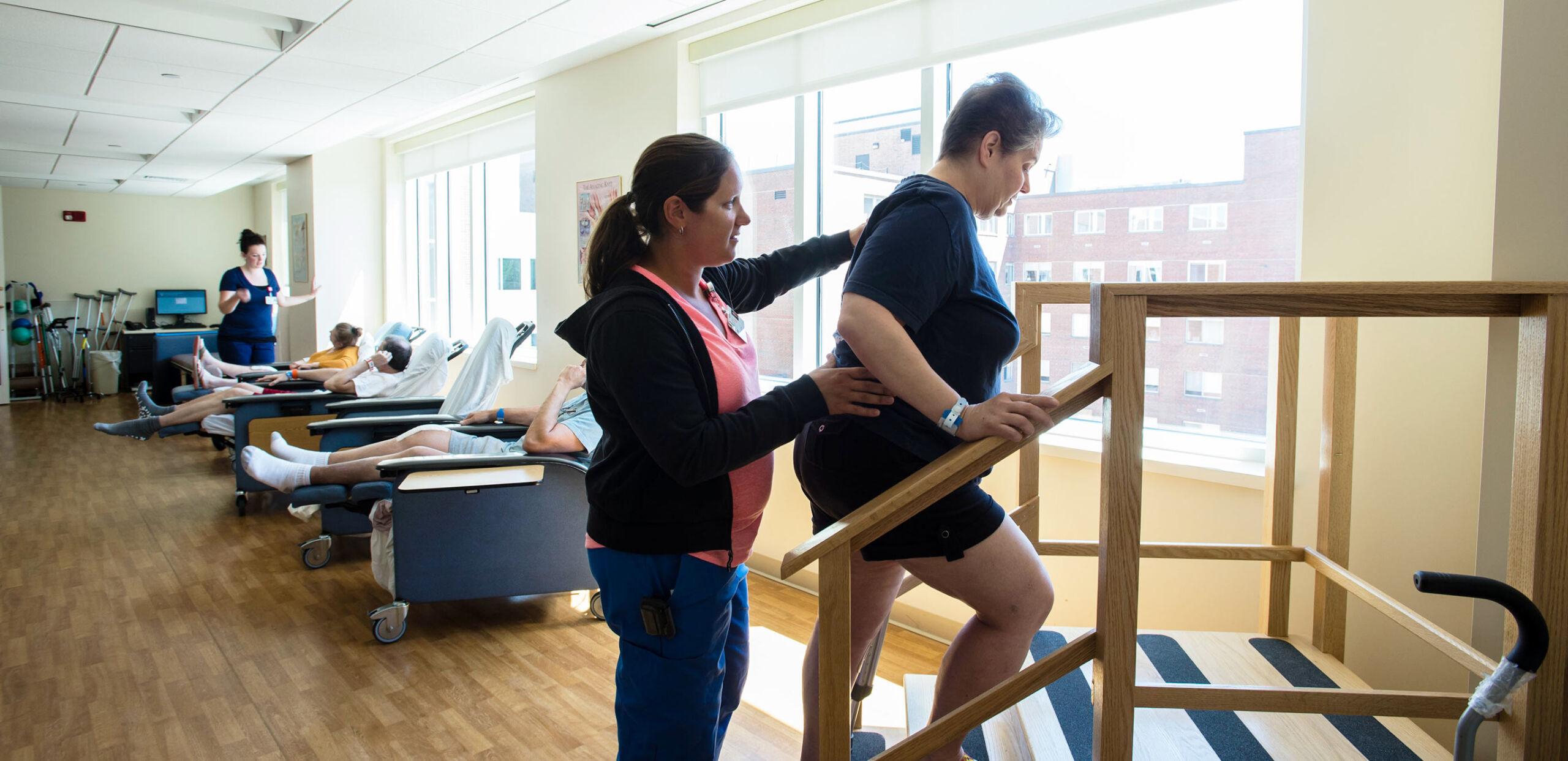 Provider helps a patient practice walking up stairs at the Joint Replacement Center at Cooley Dickinson Hospital, Northampton, MA 01060