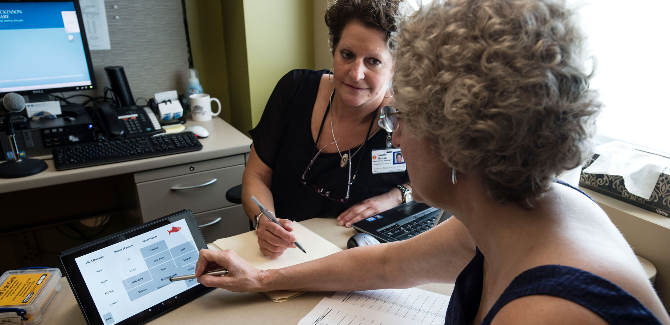 Speech therapist Laurie Korza works with a patient as she practices saying specified words at Cooley Dickinson Rehabilitation Services, Northampton, MA 01060.