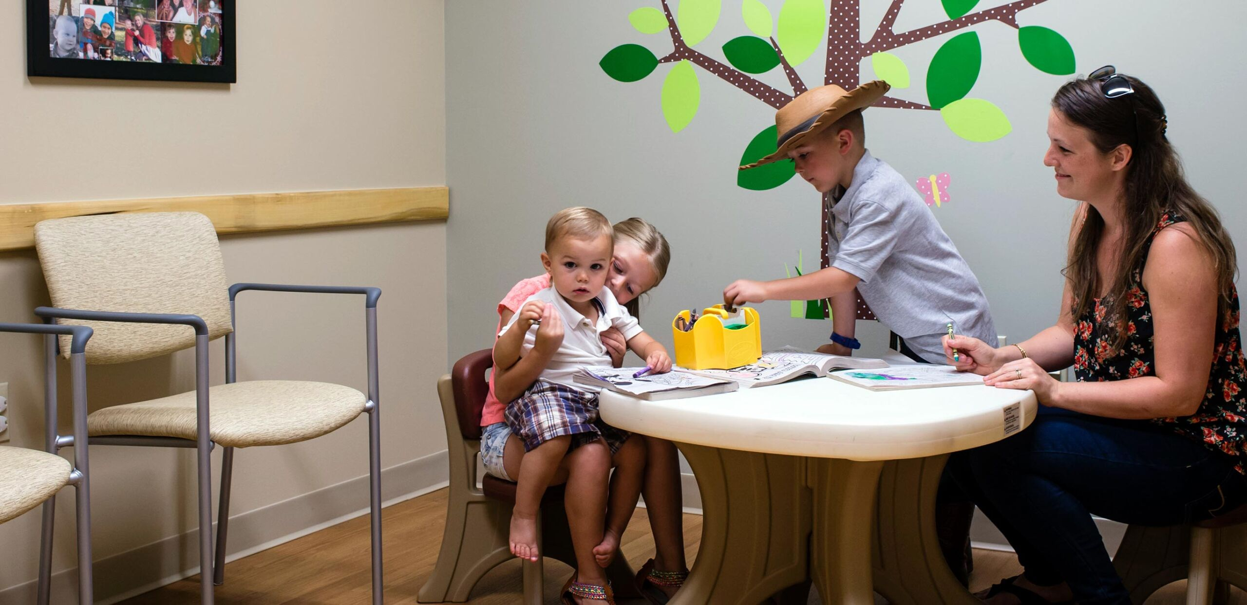 Mothers play with their children in children's area of waiting room at South Deerfield Family Medicine and Sugarloaf Pediatrics, 29 Elm Street, South Deerfield, MA 01373.