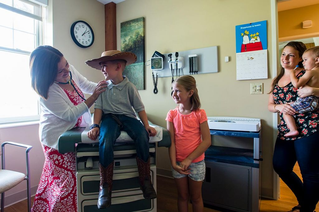 Gina O'Brien, MD, examines a young patient while family members look on at Sugarloaf Pediatrics, 29 Elm Street, South Deerfield, MA 01373.