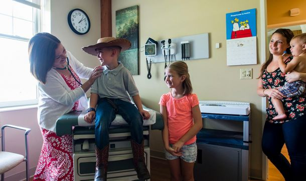 Pediatrician Gina O'Brien with patients at a recent open house at Sugarloaf Pediatrics, South Deerfield