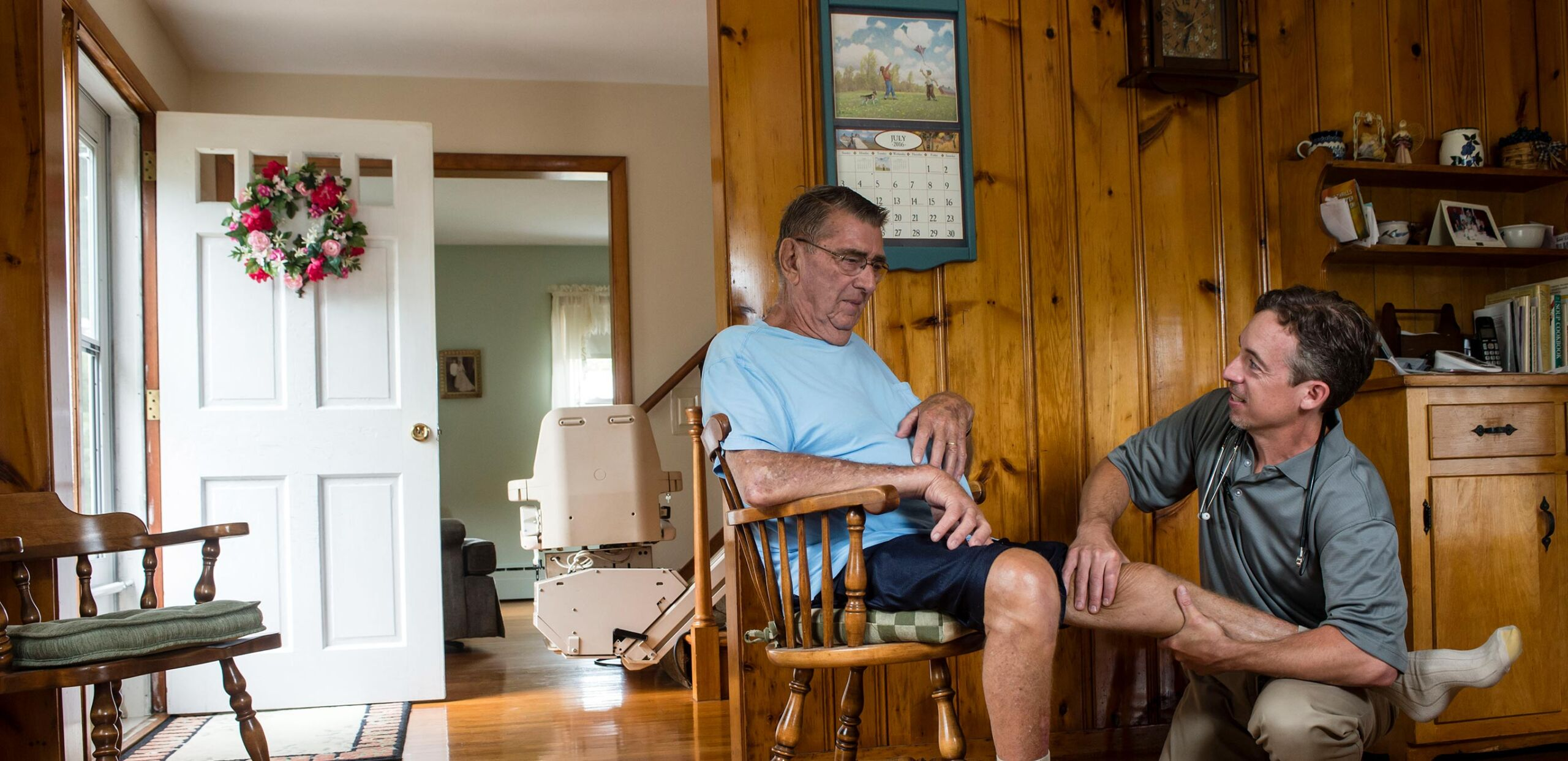 Physical therapist works with patient in his home, Cooley Dickinson Medical Group VNA and Hospice, Northampton, MA 01060.