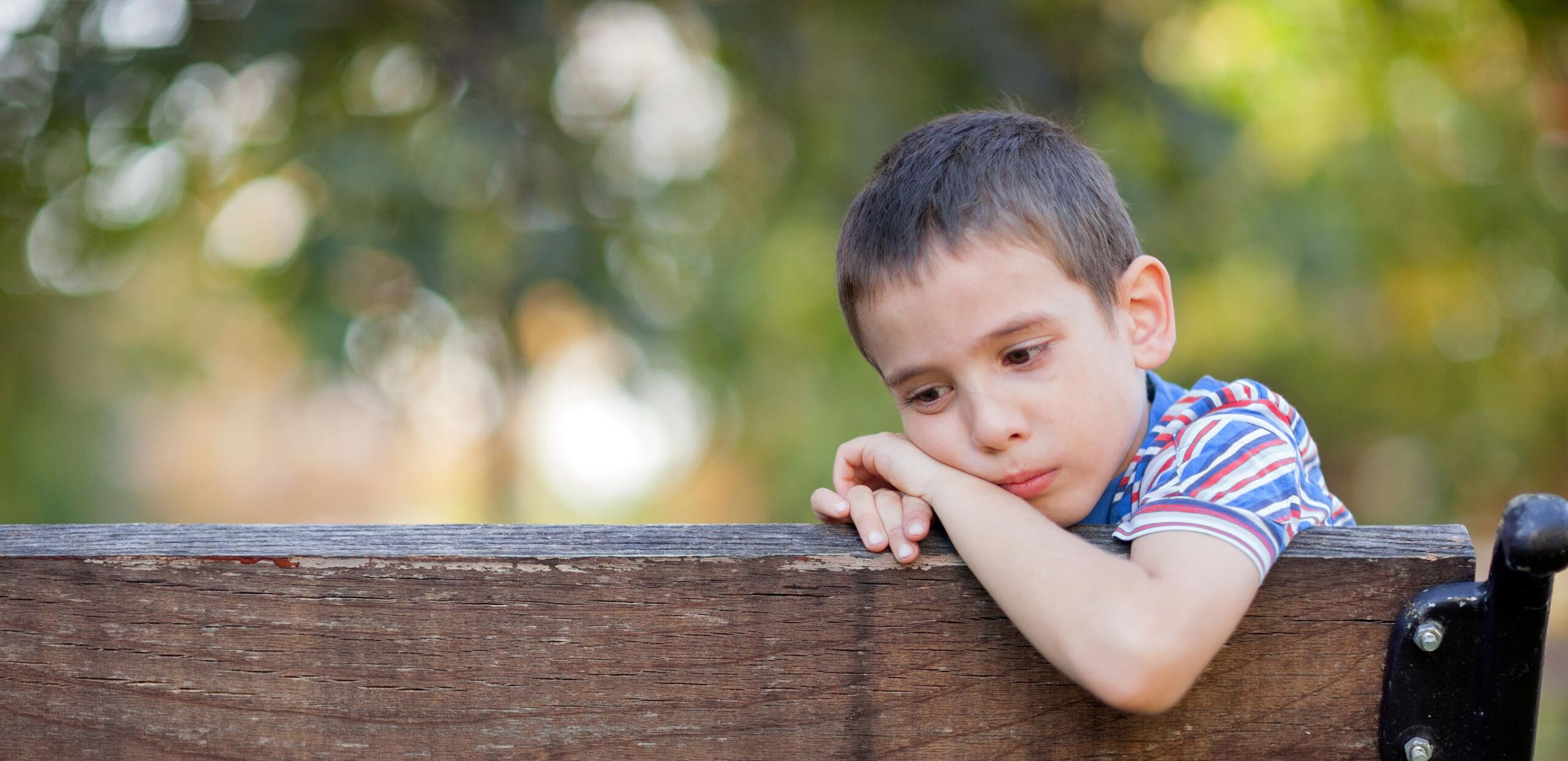 Grieving boy on bench, The Garden, Cooley Dickinson Medical Group VNA and Hospice, Northampton, MA 01060.