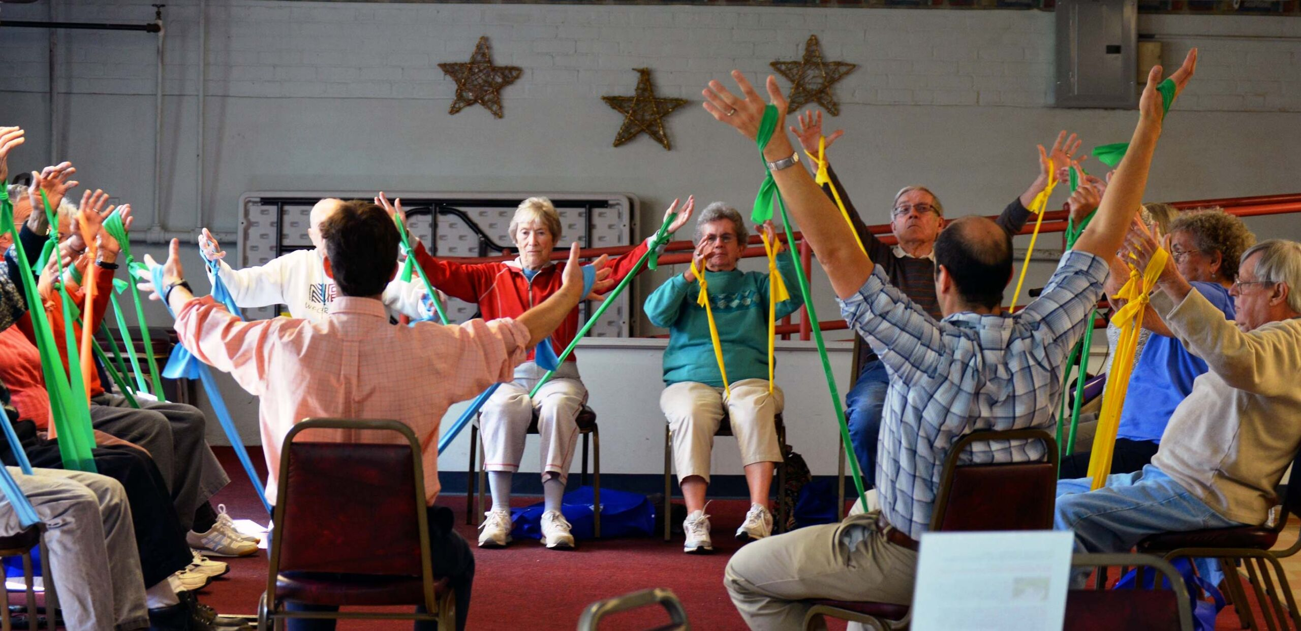 Seniors use stretch bands in an exercise class, Cooley Dickinson Medical Group VNA & Hospice, Northampton, MA 01060.