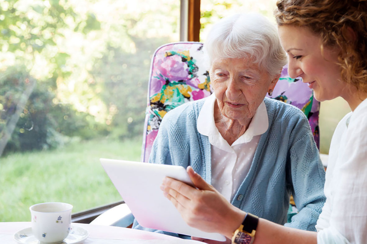 Social worker reviews forms with elderly client, Cooley Dickinson Medical Group, Northampton, MA 01060.