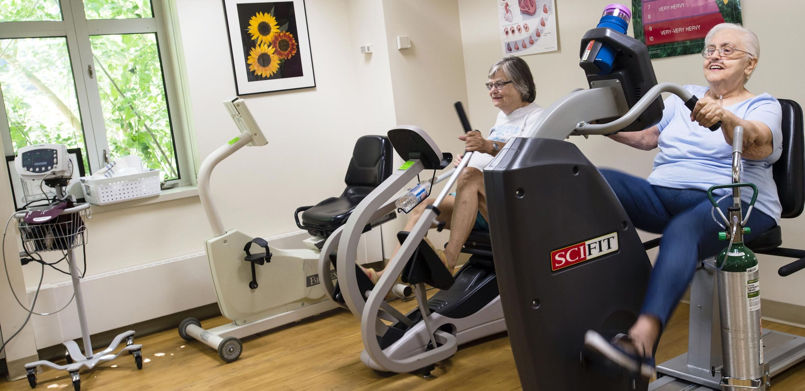 Two women using stationary exercise equipment in the Cardiopulmonary Rehabilitation Center at Cooley Dickinson Hospital, Northampton, MA 01060.
