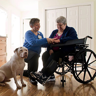Visiting nurse talks with female client in wheelchair in her home, Cooley Dickinson Medical Group VNA & Hospice, Northampton, MA 01060.