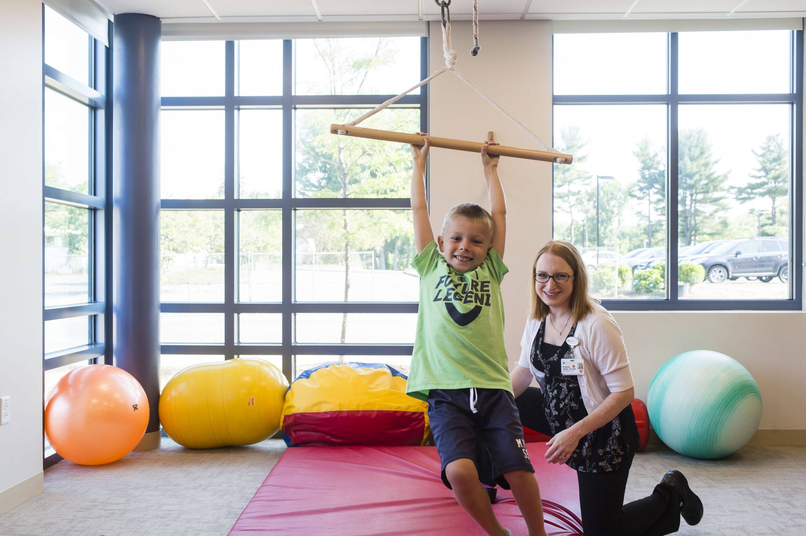 Physical therapist works with young patient at Cooley Dickinson Rehabilitation Services, Northampton, MA 01060.