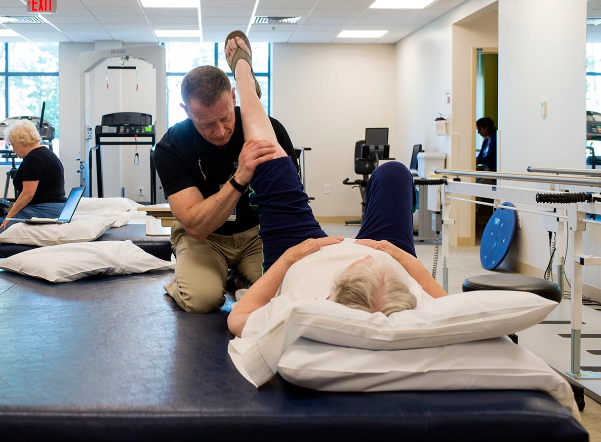 Physical therapist works with female patient on leg exercises at Cooley Dickinson Medical Group Orthopedics & Sports Medicine, West Hatfield, MA 01088.