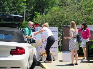 Steve Lewis and Tracy Stearns of Steve Lewis Subaru unload boxes of care items for Cooley Dickinson cancer patients.