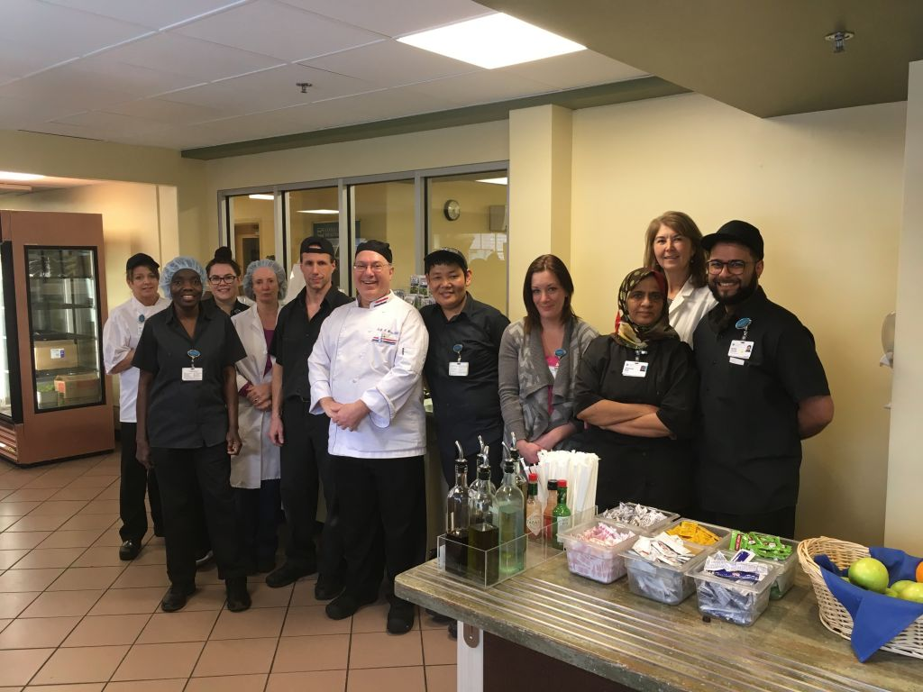 Gary Weiss, Executive Chef (Center), with members of the Cafeteria/Food & Nutrition Services team, pose for a photo recently.