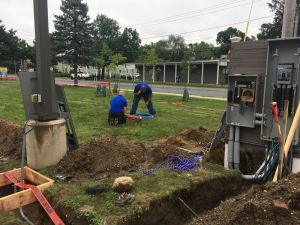 Kevin and David Glaude of Rhode Island-based DK Power begin the work of laying out where EV charging stations will live and preparing the wiring for the charging units, scheduled to be delivered in mid-August.