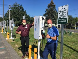 Cooley Dickinson Director of Support Services Tim Culhane and Facilities Director Jon Slater stand by the just-installed EV stations.