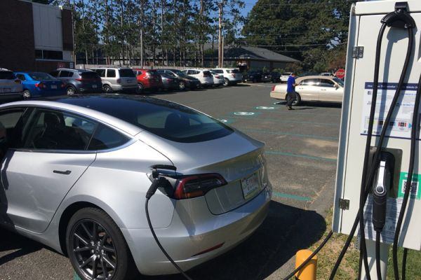 An early customer plugs in just hours after the EV charging stations went live.